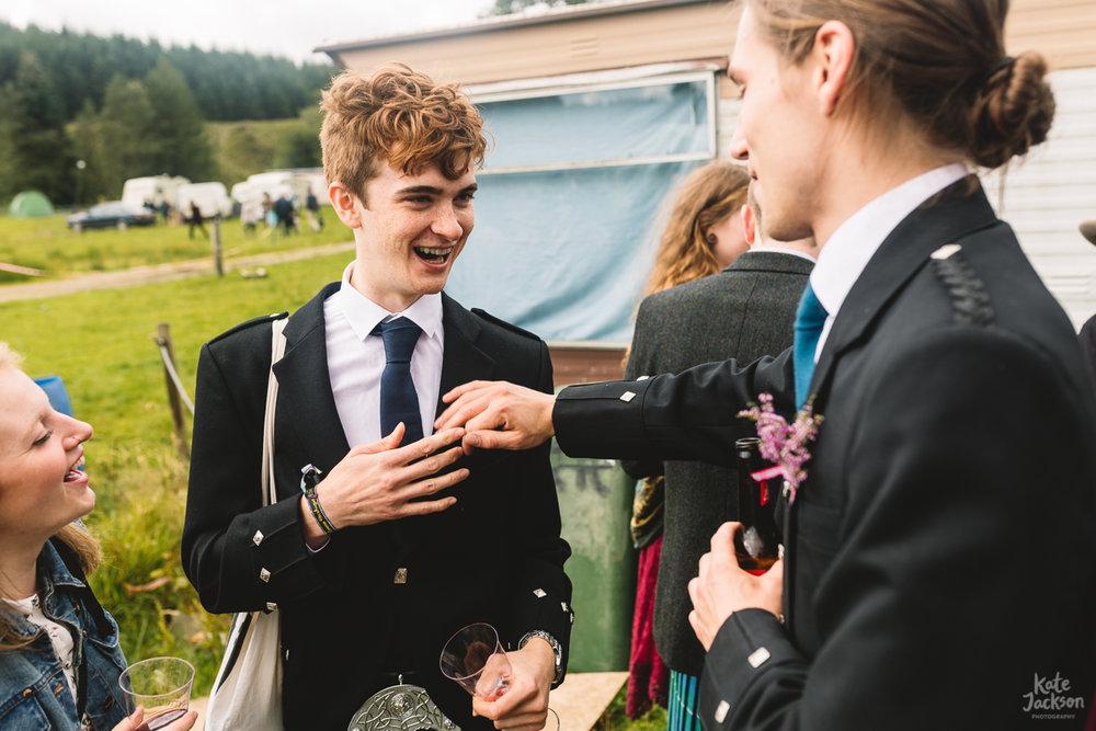 Kilts at alternative festival wedding in Scotland