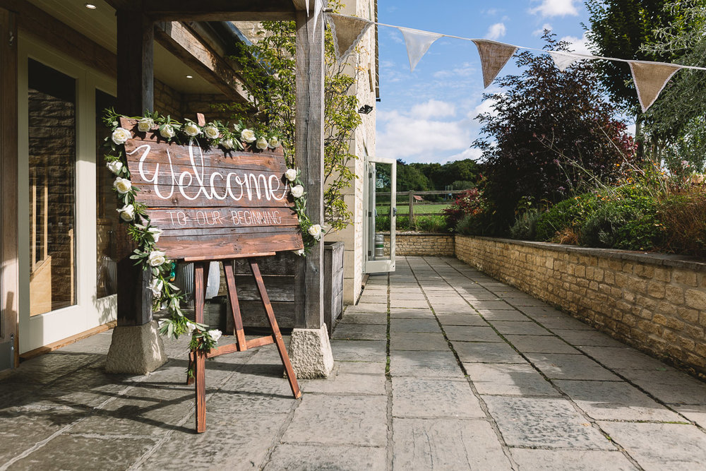 Hyde Barn Wedding Rustic Signage with Flowers