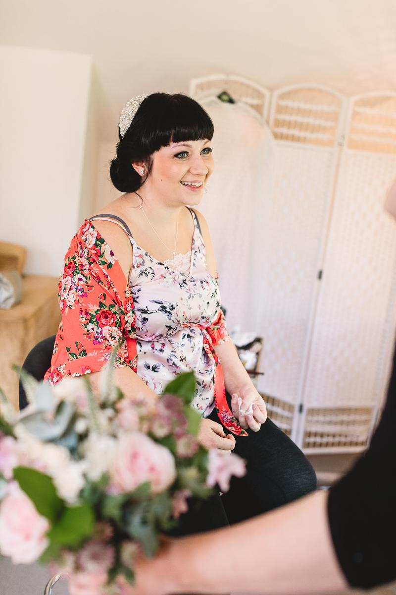 Bride having fun and smiling at Hyde Barn | Kate Jackson Photography
