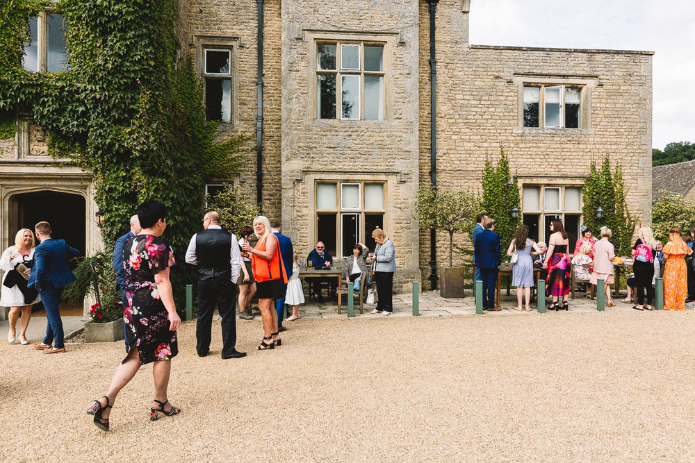 Guest arriving outside hyde barn | Documentary Wedding Photography