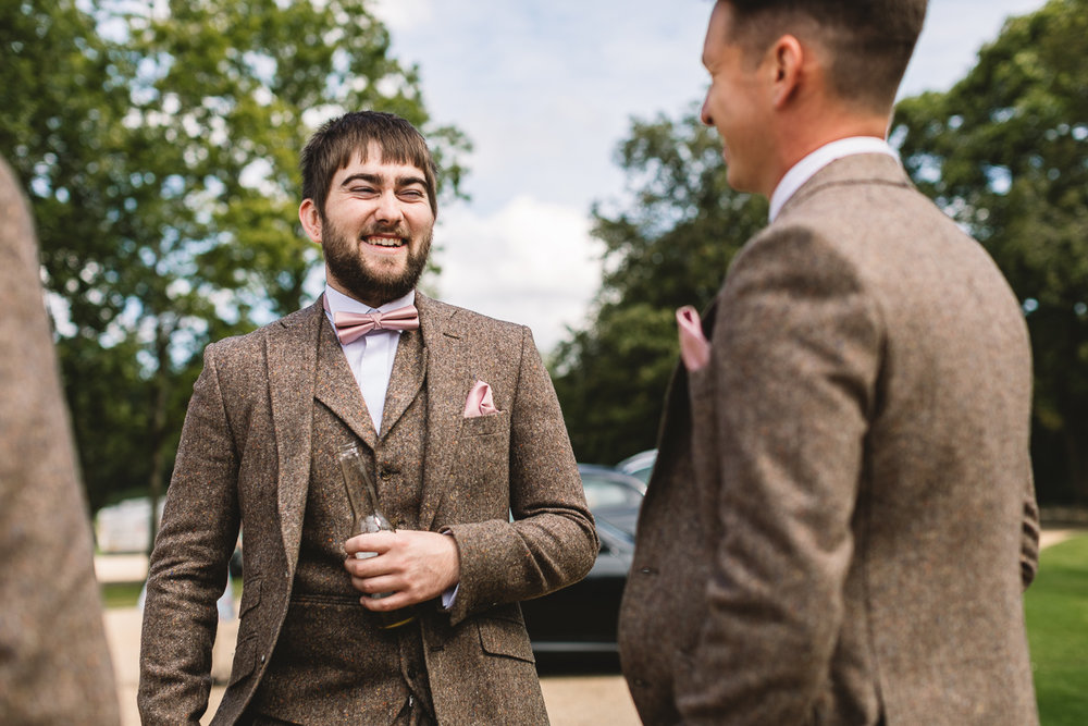 Groom Laughing and having fun at Hyde Barn Wedding