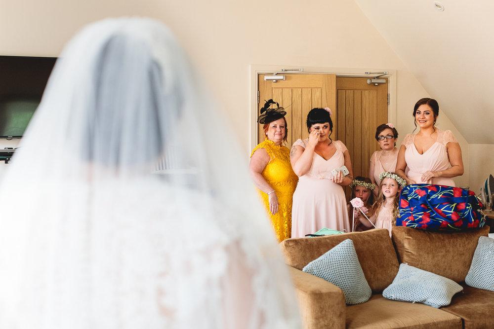 Bridesmaid shedding tears at seeing bride | Natural Wedding Photography
