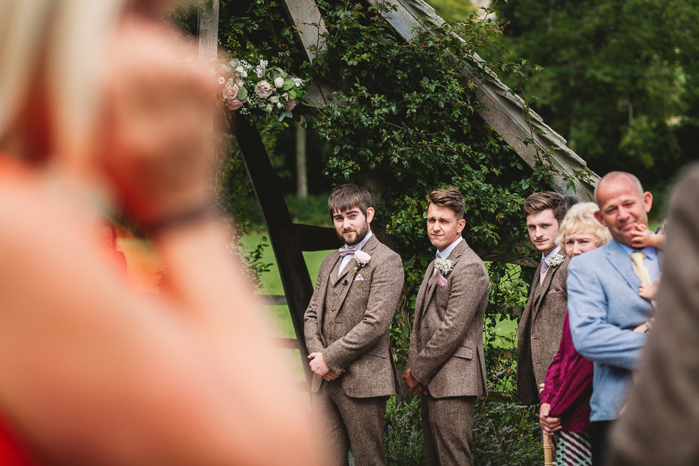 Groom first look at relaxed outdoor hyde barn wedding