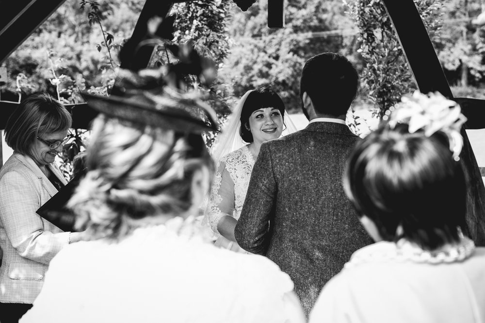 Tears during vows at in natural outdoor summer wedding