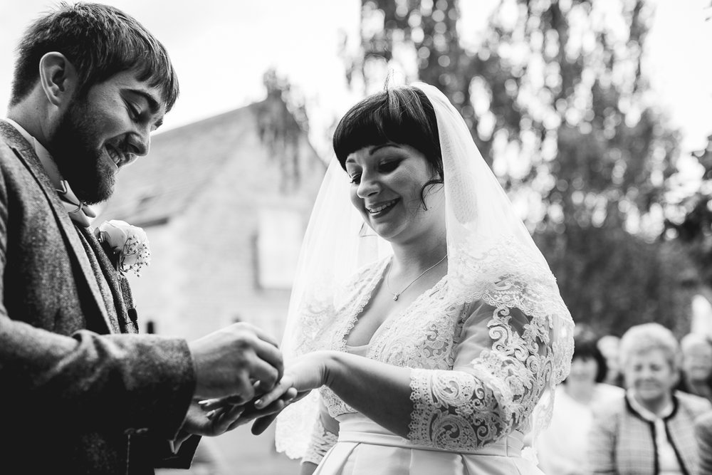 Ring exchange at relaxed Hyde Barn Wedding Ceremony