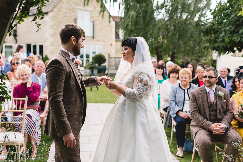 Ring exchange during relaxed Hyde Barn Wedding Ceremony