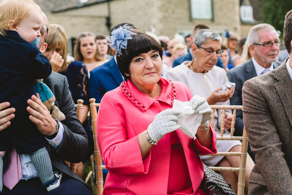Mother of the groom sheds tear at outdoor wedding ceremony in the Cotswolds