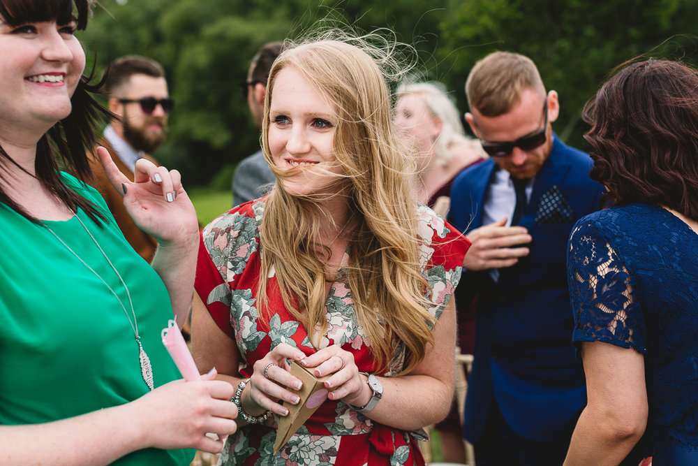Outdoor Wedding in the Cotswolds candid moment of fun laughter