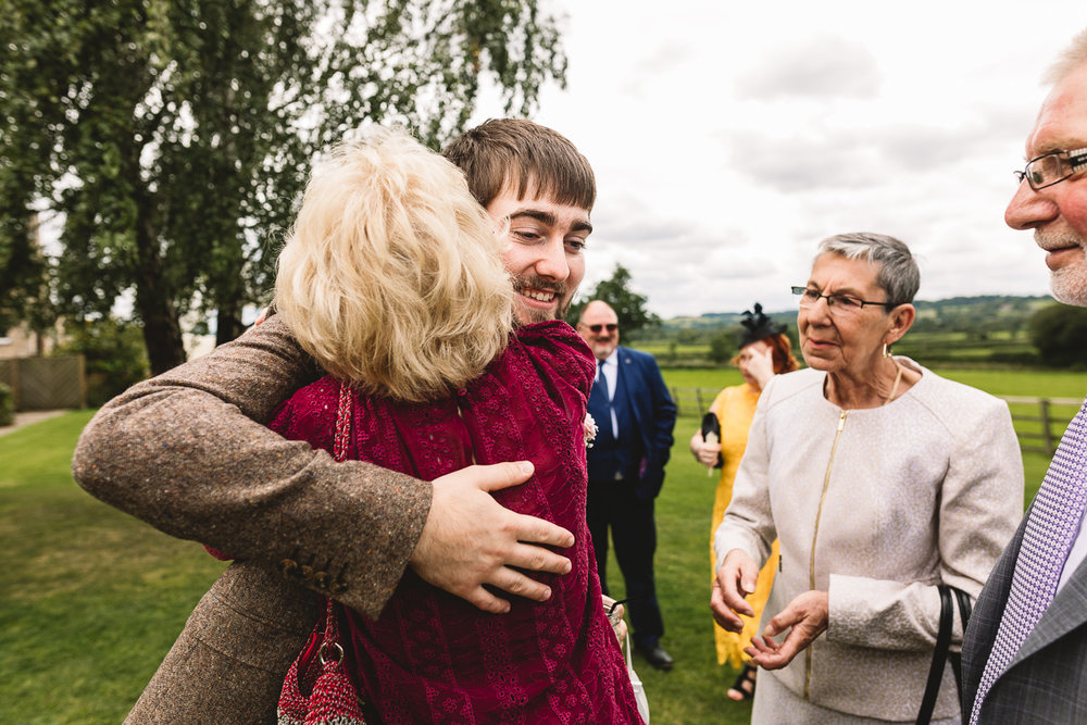 People hugging | natural candid moments at Hyde Barn Wedding