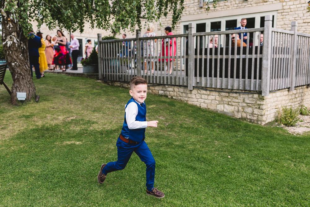 Page boy runs along at fun DIY Outdoor Wedding