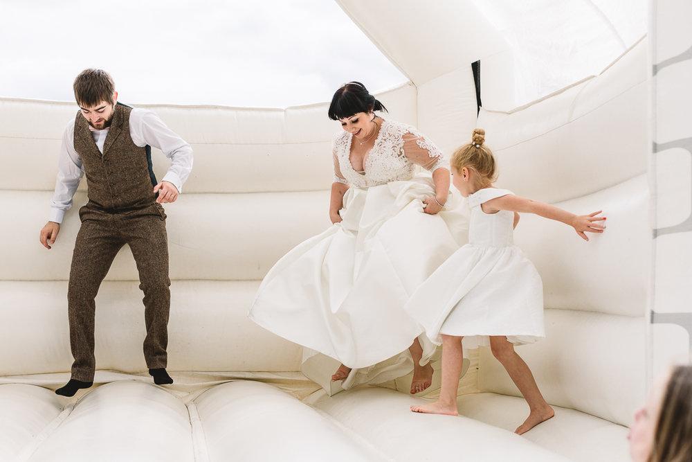 Hyde Barn Weddings Bouncy Castle with Bride having fun