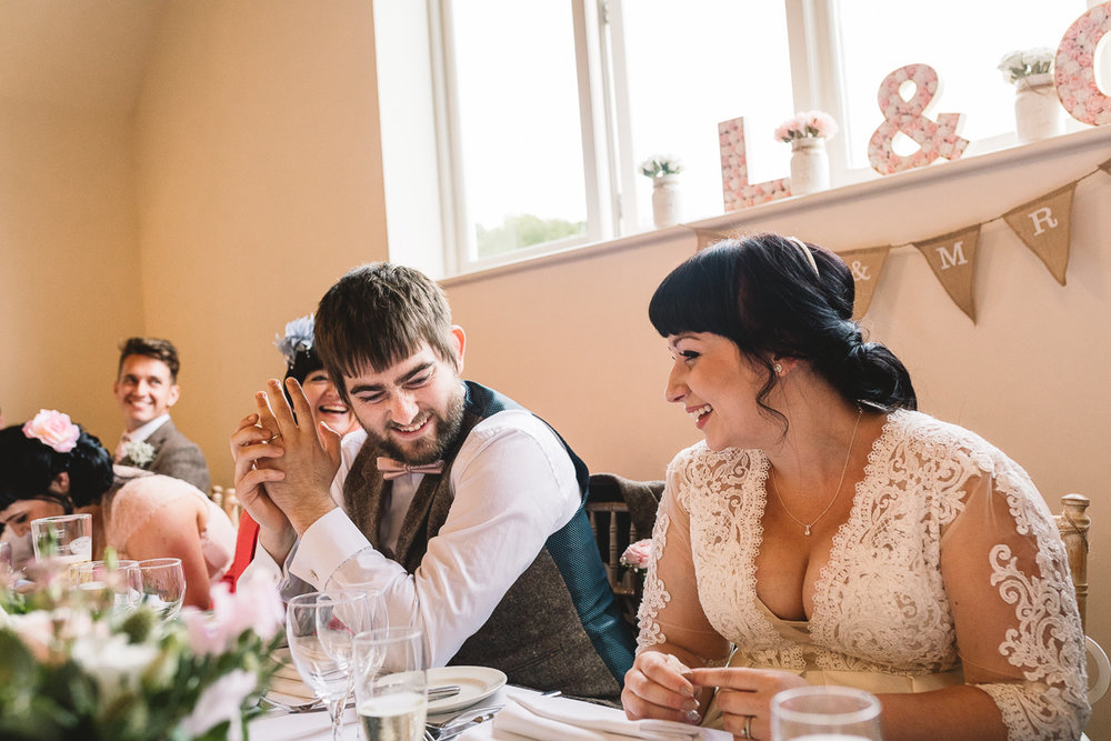 Groom smiles at Cotswolds wedding with rustic DIY touches