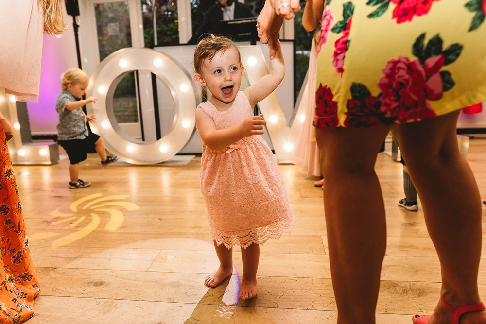Fun photo of flower girl dancing