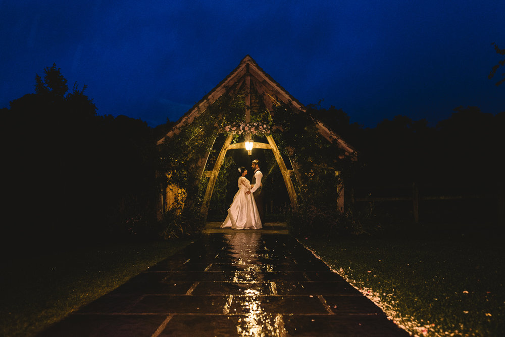 Bride and Groom standing under awning at Hyde Barn | Natural Wedding Photographer