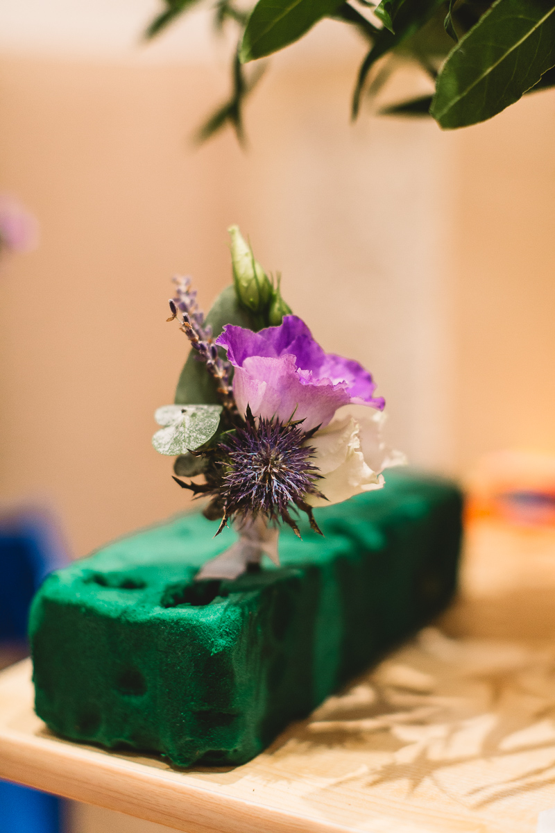 Boho purple buttonhole with thistle at relaxed france wedding
