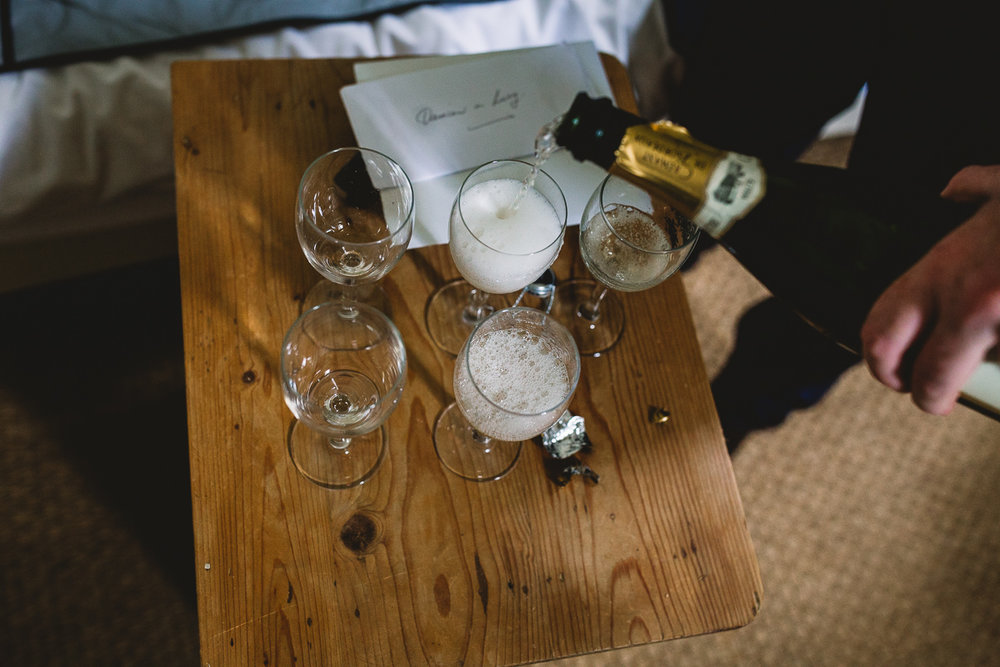 Fun groom prep with champagne at france destination wedding