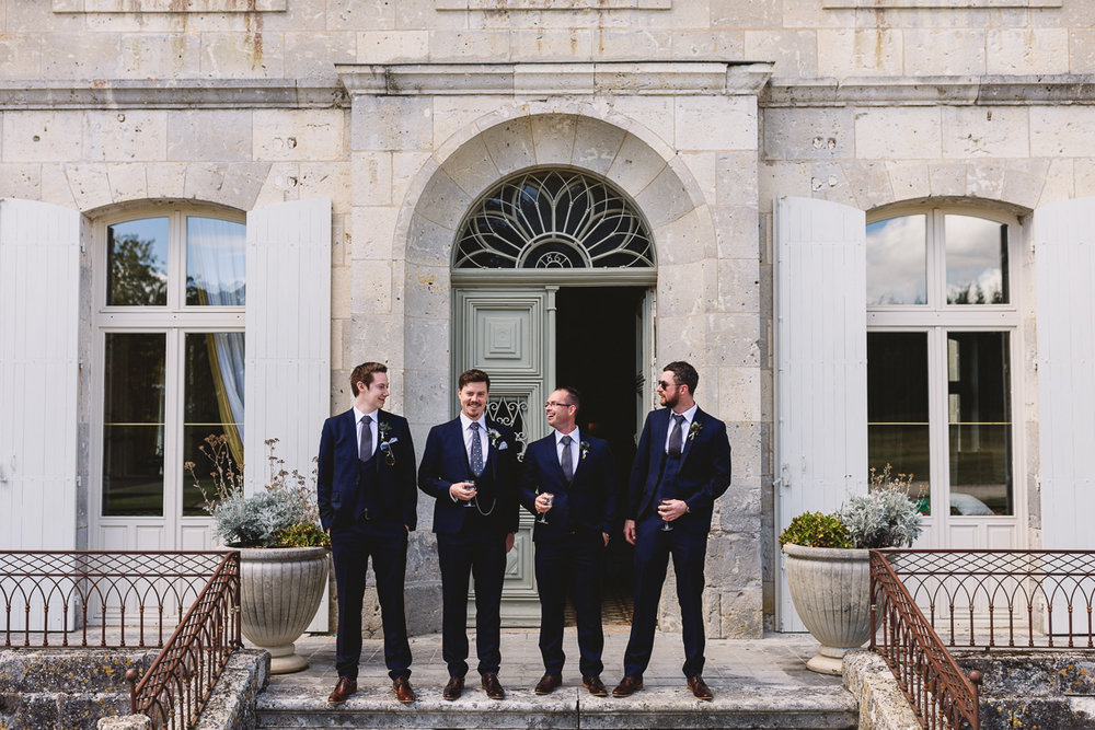 Groomsmen in blue suits at Chateau Lasfargues france destination wedding