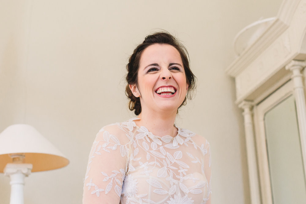 Fun bride smiling in boho Rue De Seine dress at Chateau wedding in France