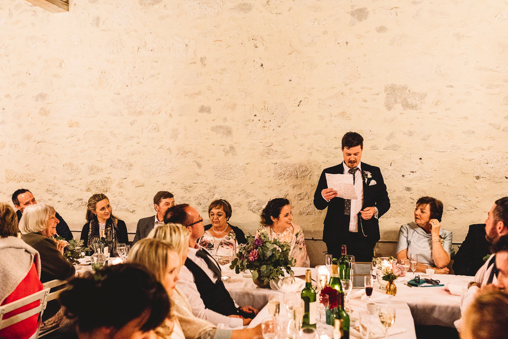 Groom wedding speech at rustic destination wedding in france