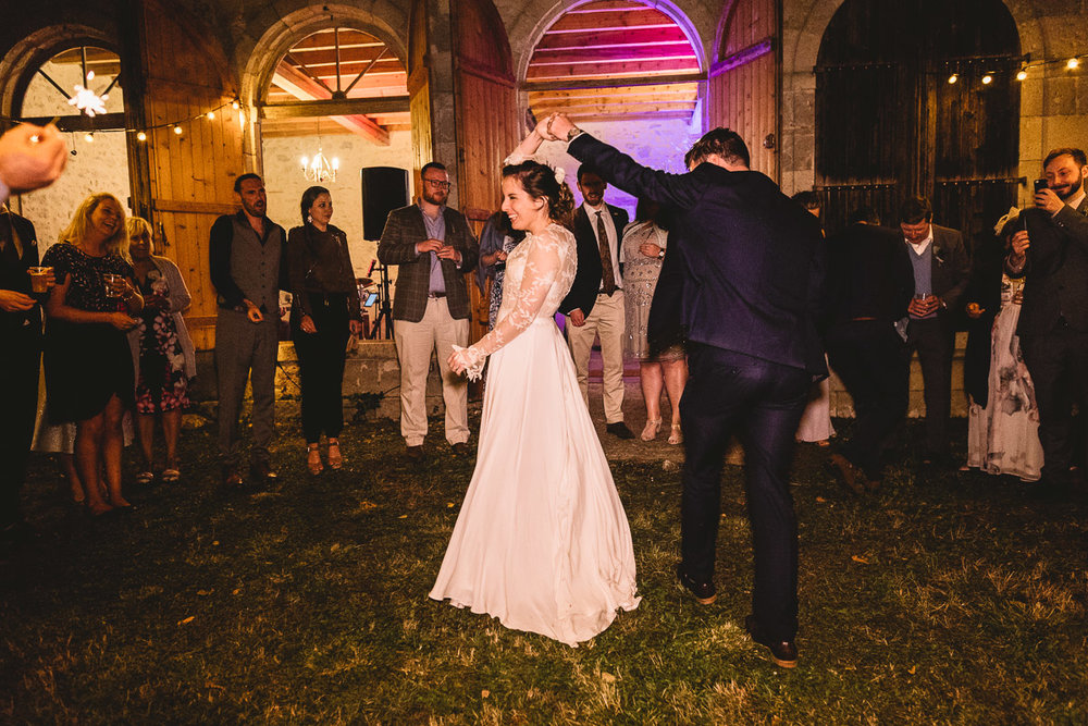 Outdoor first dance at chateau wedding in france with a bride in a Rue De Seine dress