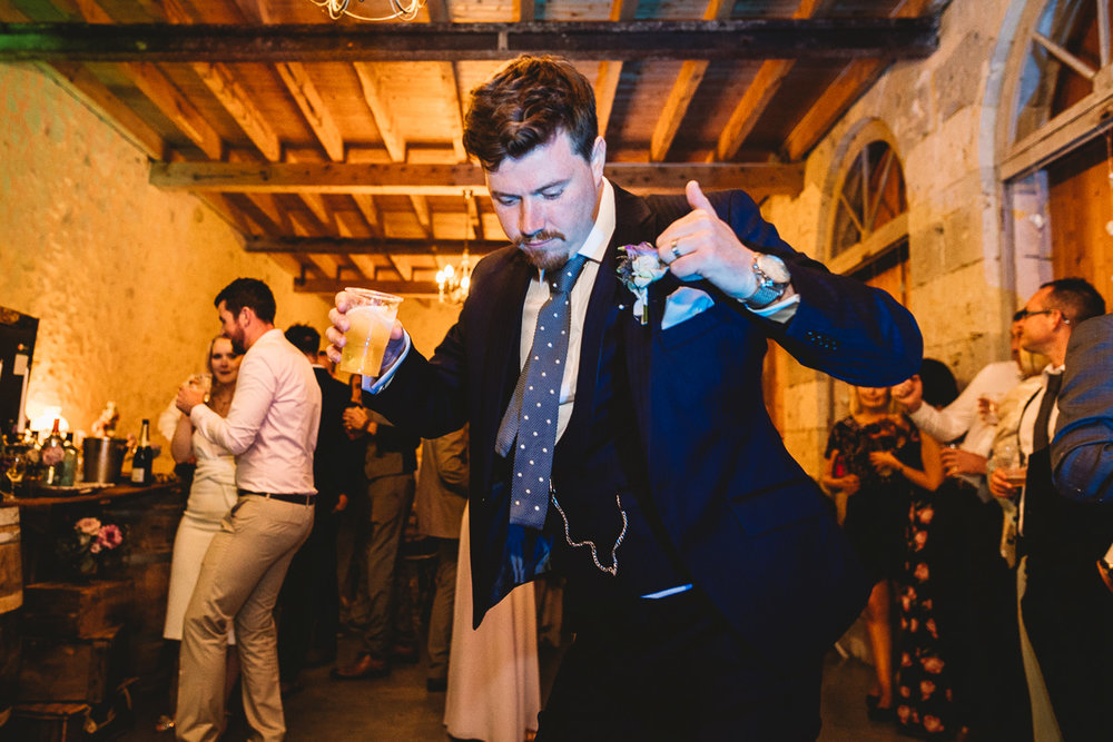 Fun groom dances at french chateau wedding