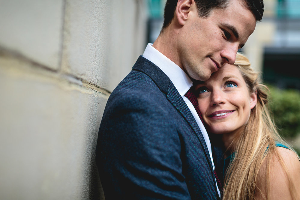 Couple embracing naturally outside of Sheffield Town Hall