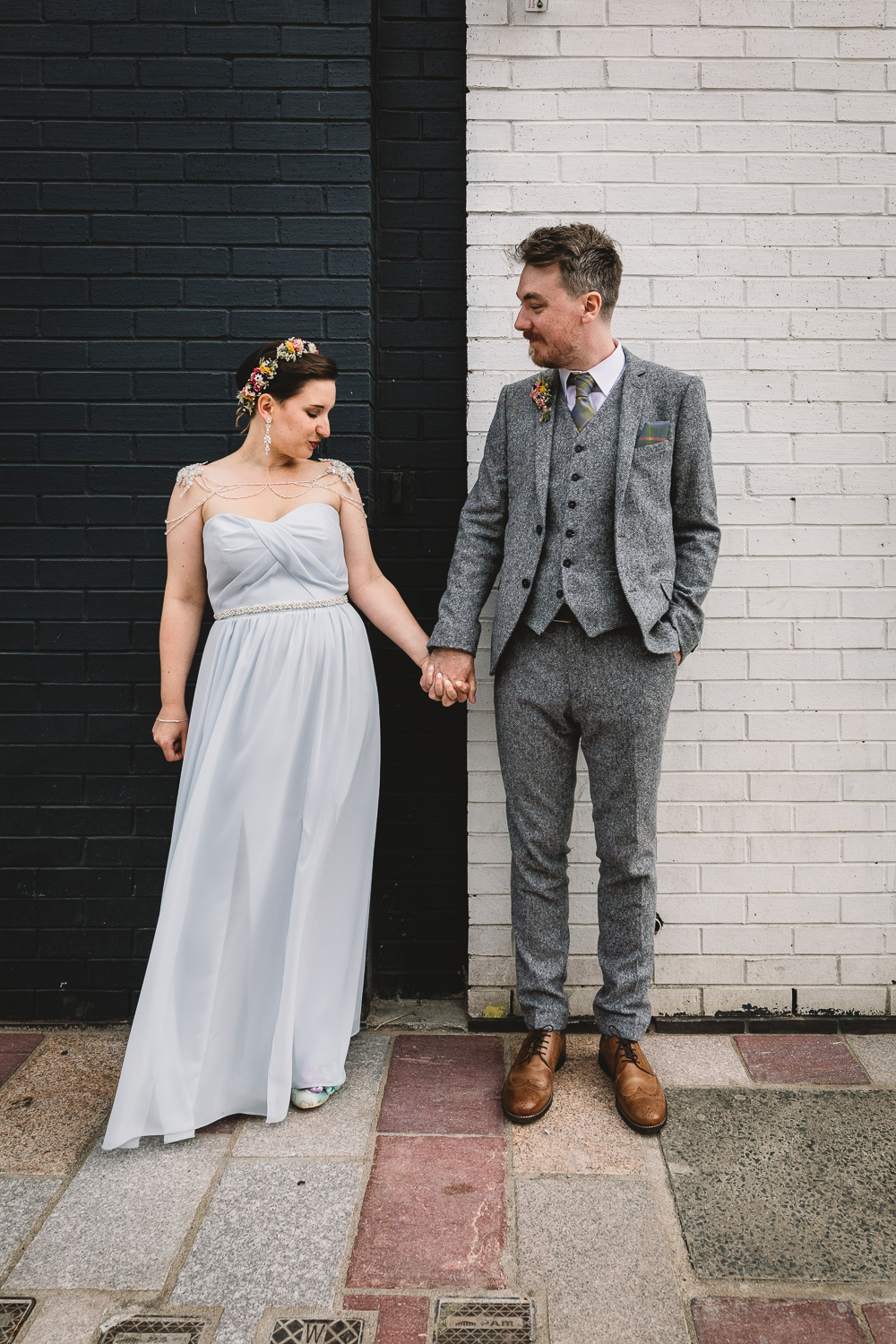 Bride and Groom in front of black and white block colour wall during natural couple photos | Shropshire wedding photographer