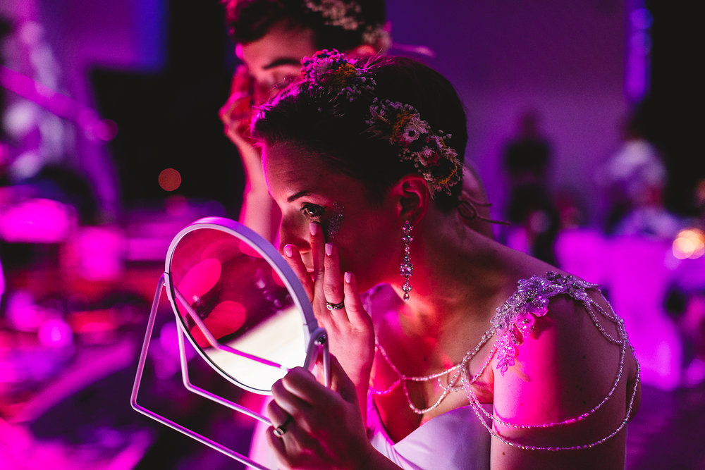 Eco glitter bride with short pixie cut and dried flower crown is putting on glitter at fun wedding in birmingham