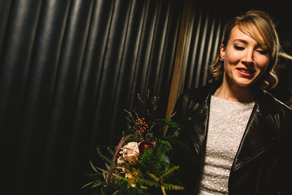 Bride in a quirky lift in Hoxton Hotel in Shorditch.