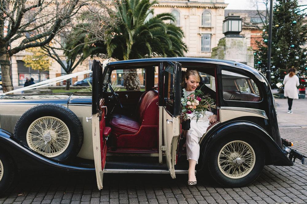 Bride and vintage car on Hackney London street