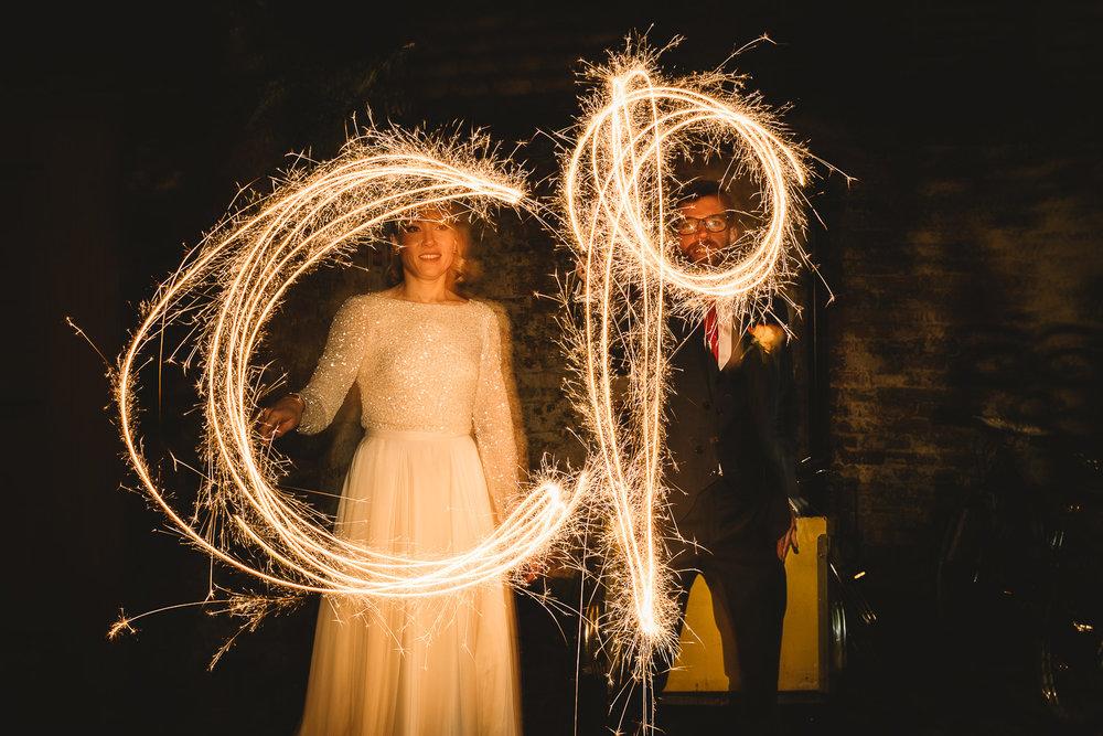 Long exposure couple alternative wedding portrait with sparklers