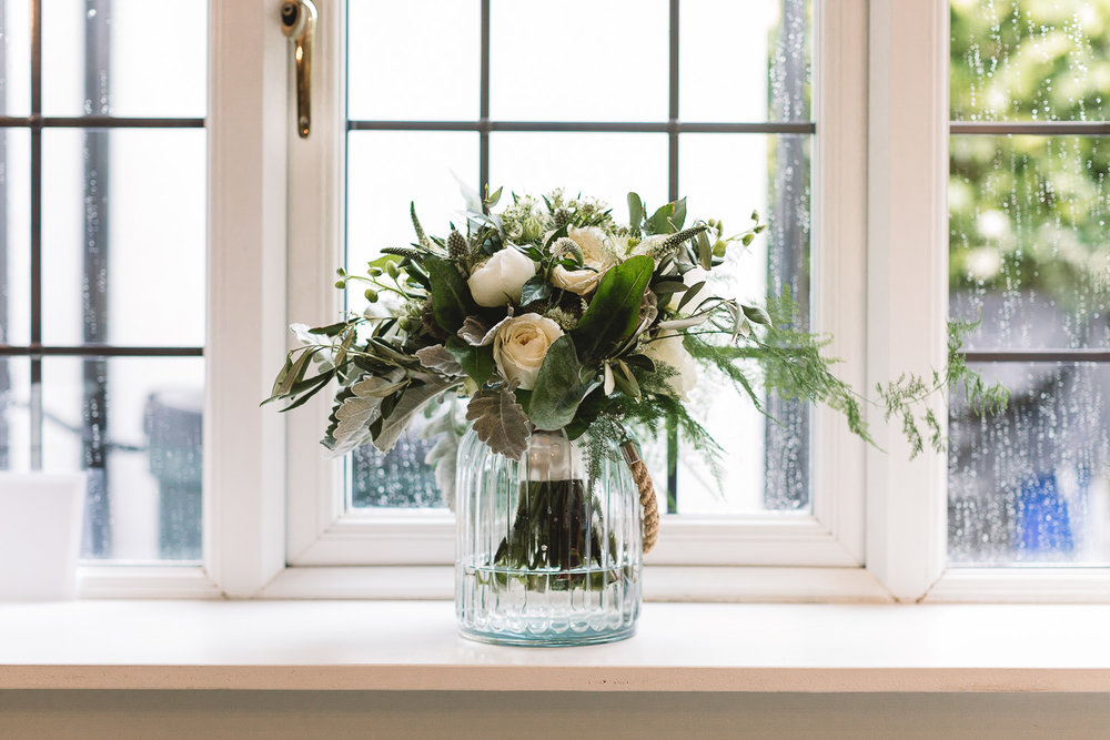 Wedding detail of rustic and classic bouquet with roses and green foliage from Moss and Clover Kelham florist in Sheffield