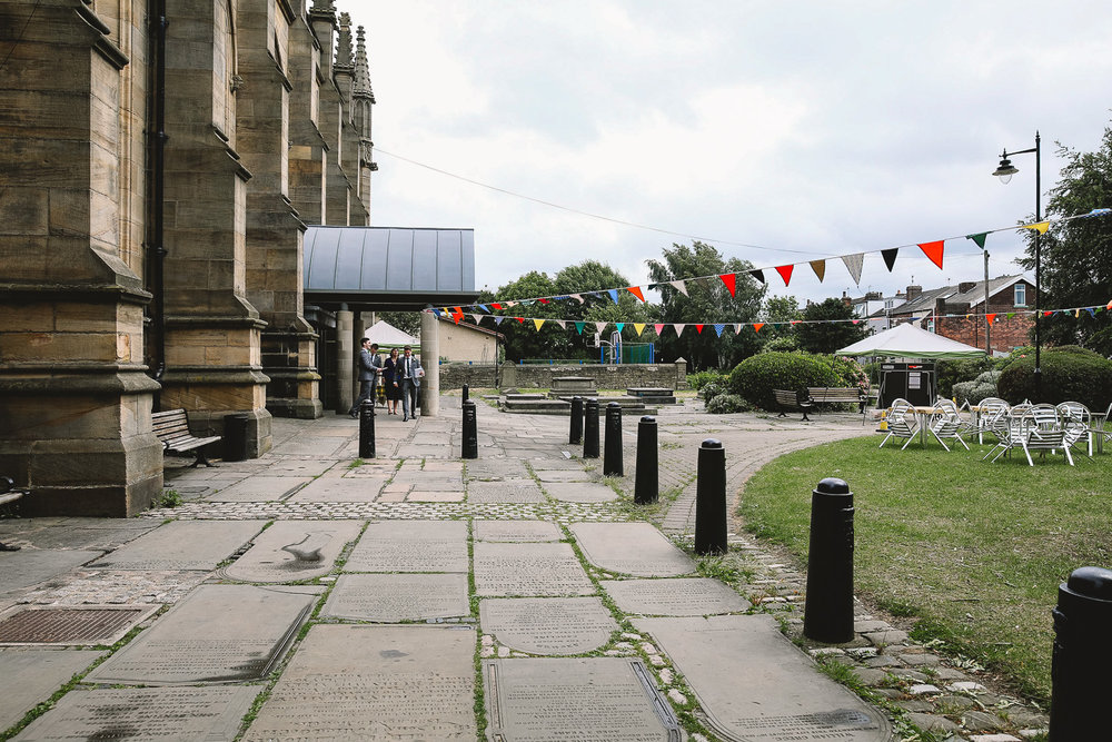 Exterior of St Marys Church in Sheffield with fun colourful bunting hanging outside