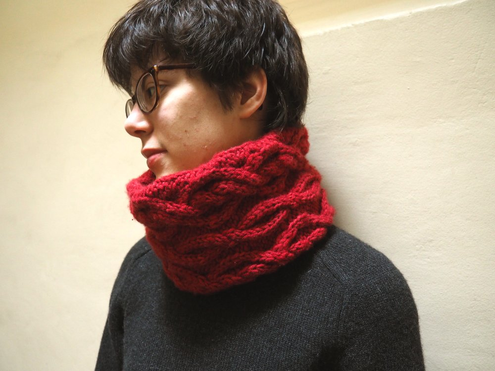 Corinthe Cowl has a beautiful cable pattern knitted horizontally in the round with a provisional cast on.