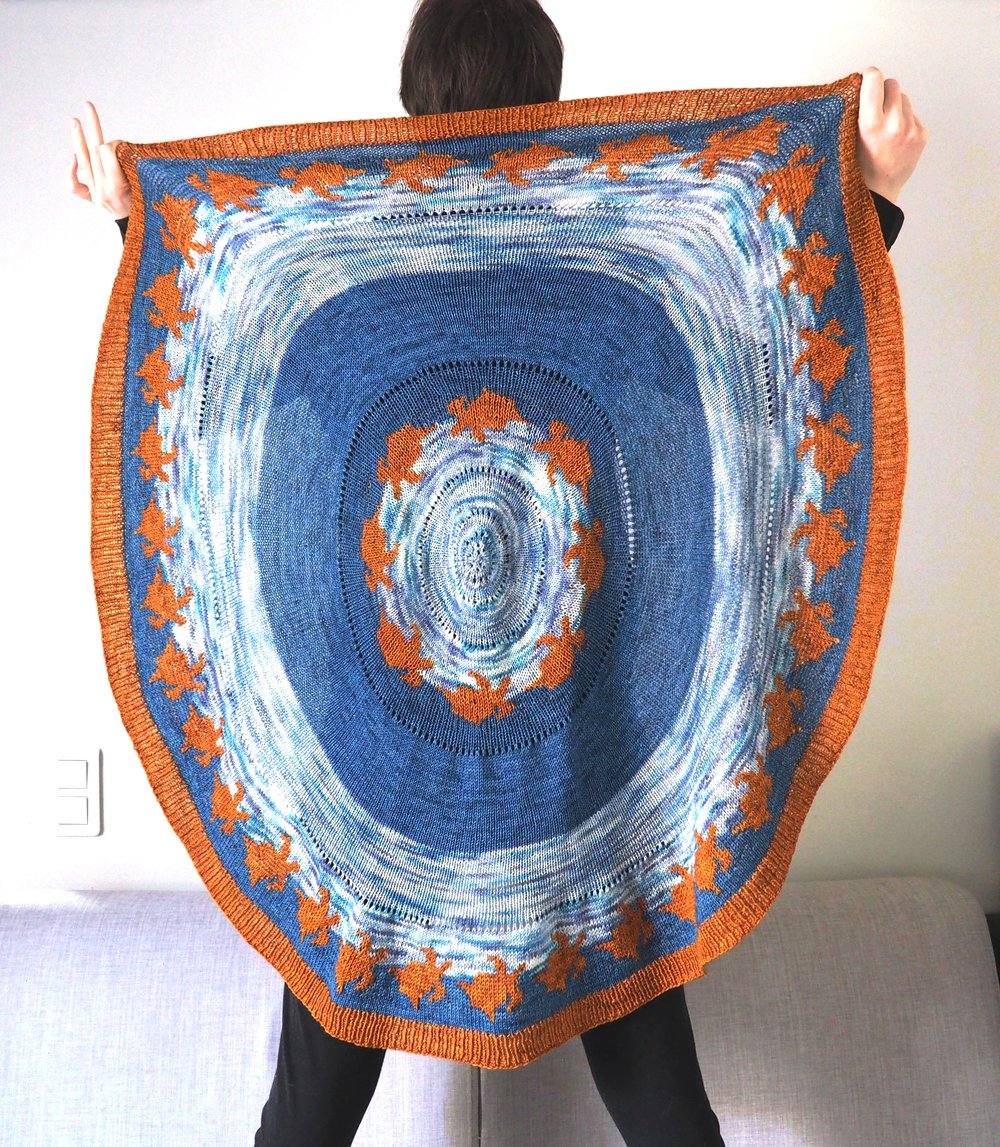 Sea Turtle Shawl - This shawl represents sea turtles traveling the oceans to new horizons.With its interesting construction, it will allow you to explore different color combinations while knitting the clever pi-shape.