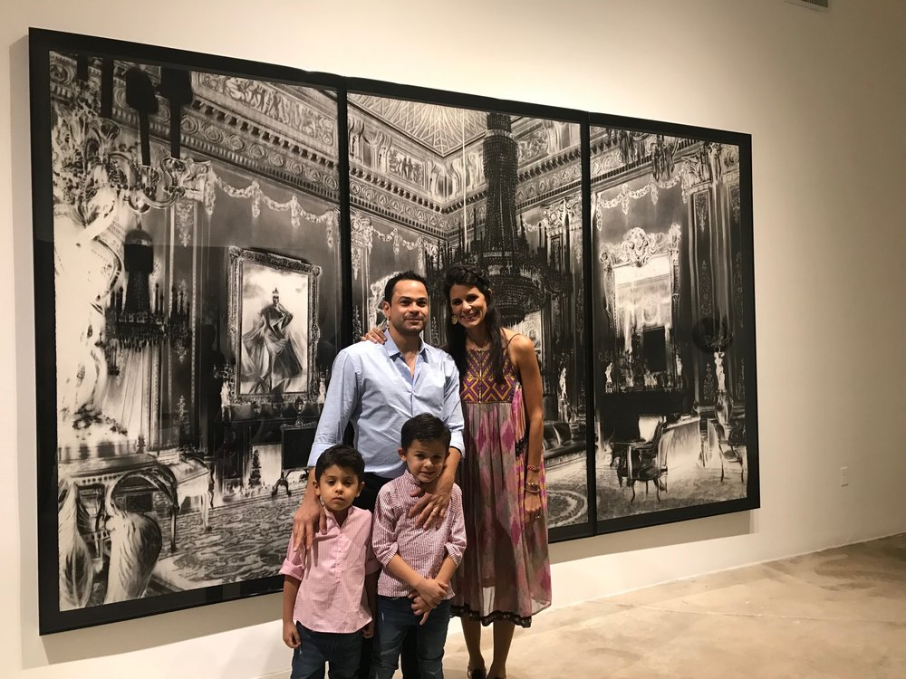 My family. This was taken recently at my husband's (@gfuenmayor) solo show in Miami. What you see behind is a charcoal drawing of his.