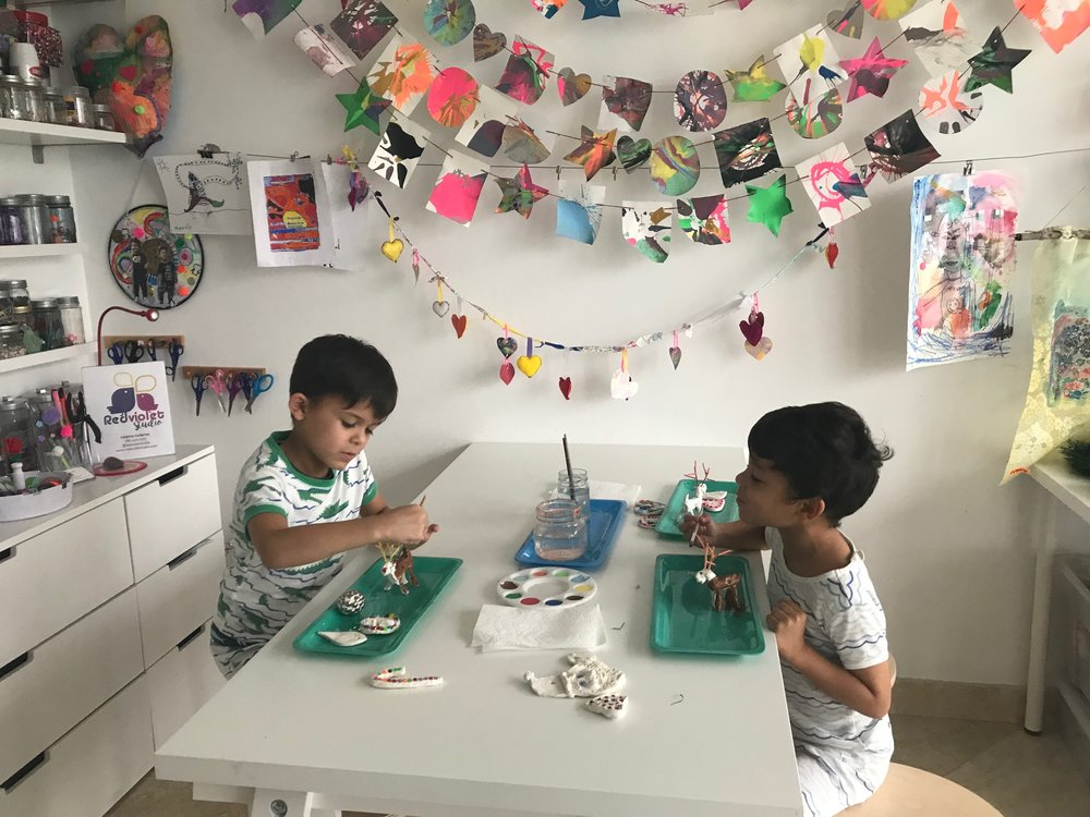 My boys at our home art studio working on some clay Christmas ornaments.