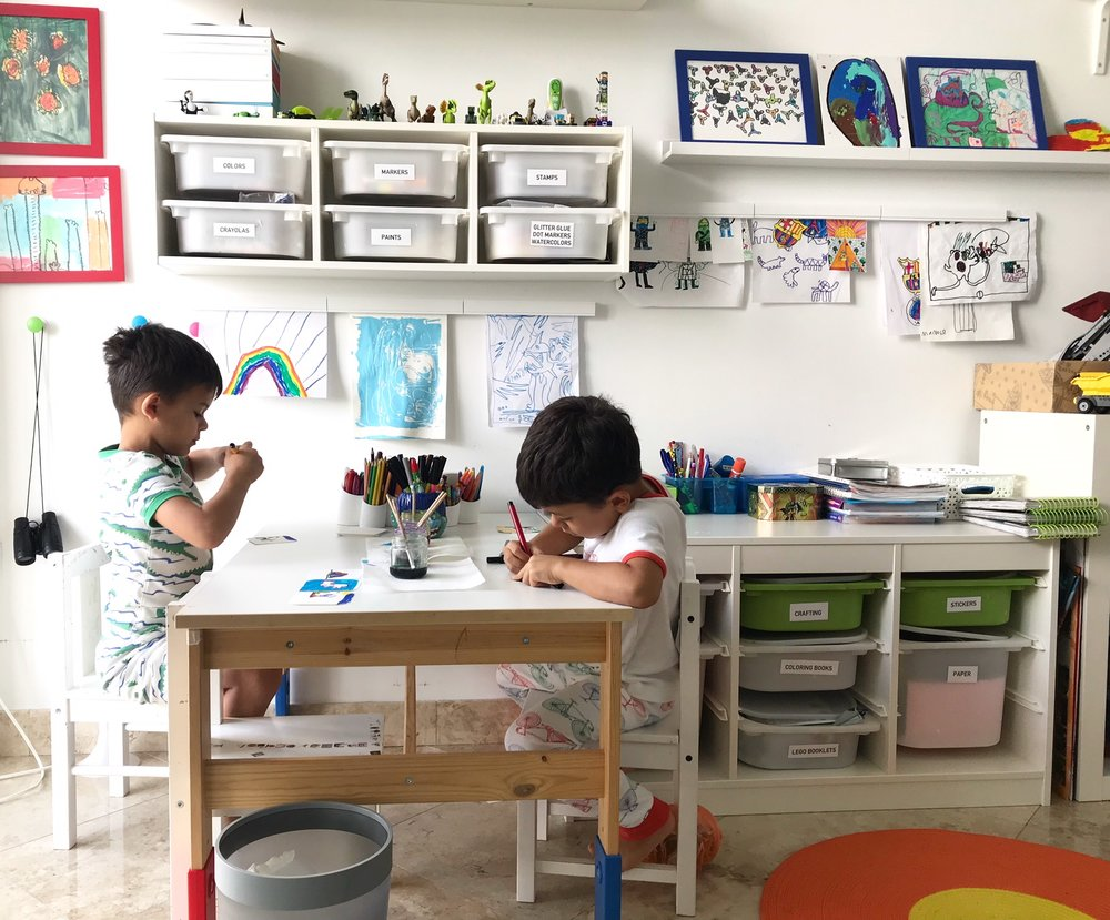 This is their creative corner in their room. A table, a couple of chairs and an organizer full of supplies for them to choose from. We also love to display their artwork. It makes them feel proud and special.