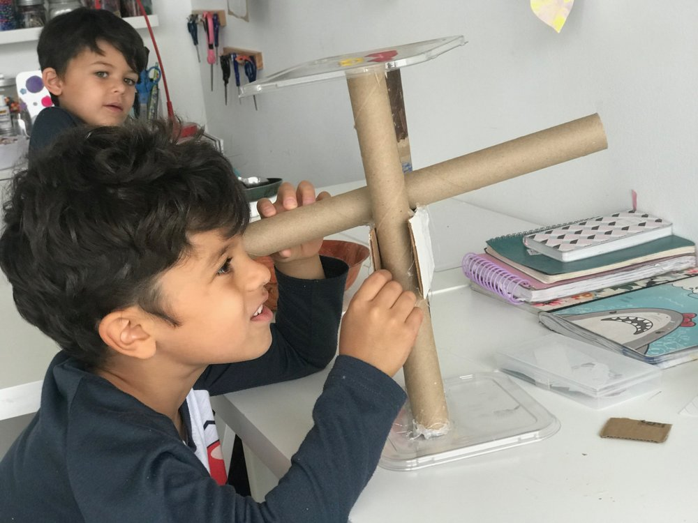 Manolo building a telescope on a Sunday morning.