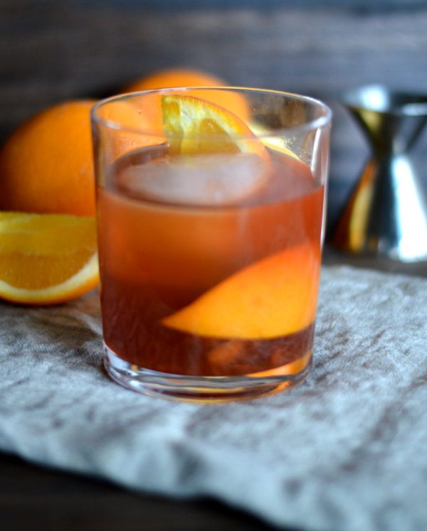 The Old Fashioned Cocktail made with Bourbon, Orange, and Simple Syrup | CaretoPair.com