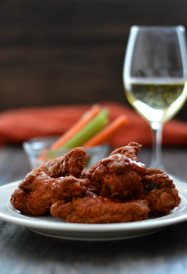 Finding wine that pairs with chicken wings can be tricky, but there are a few that work!