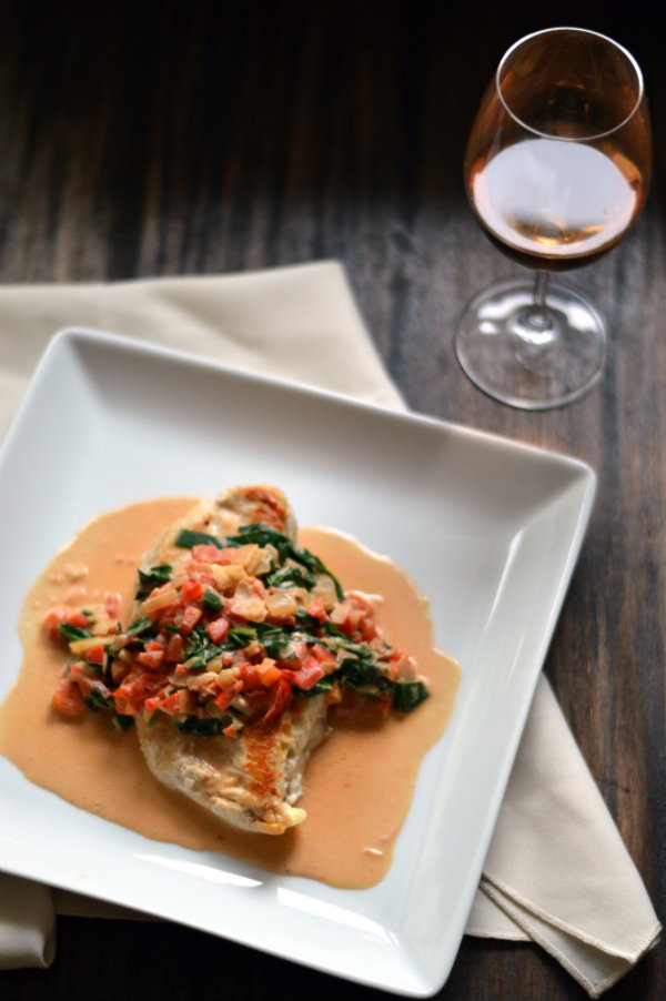 this red pepper cream sauce over pan-seared chicken breasts goes perfectly with a dry rosé | CaretoPair.com