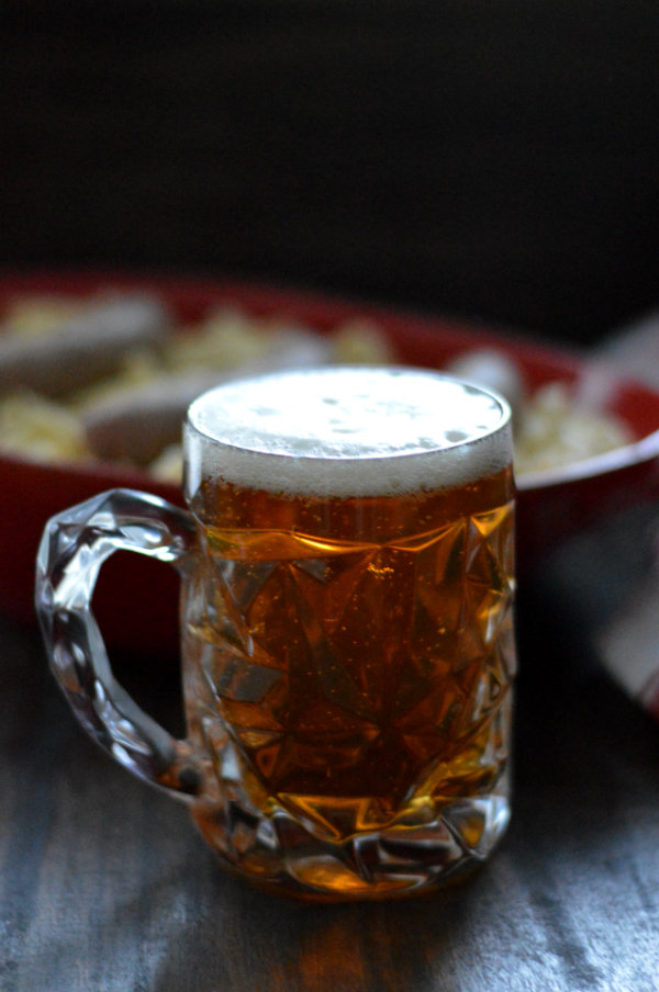 Festbier, formerly known as Oktoberfest, or Marzen, is the best beer to be in your fridge this fall. It pairs with everything, including this recipe for sweet buttery sauerkraut noodles and sausage! | CaretoPair.com