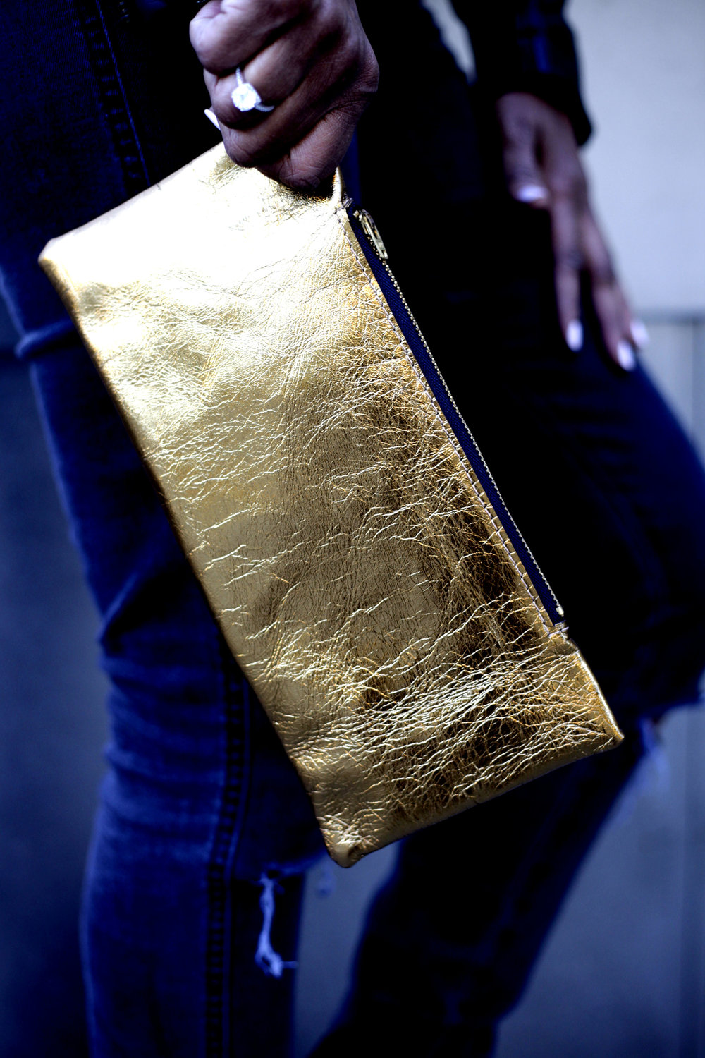 Aura Clutch - 24kt. Gold Lamb Leather Clutch. Pull zipper closure. Gold Element: FireGold Properties:Intuition. Divination. Healing. Wealth. Magical Power.