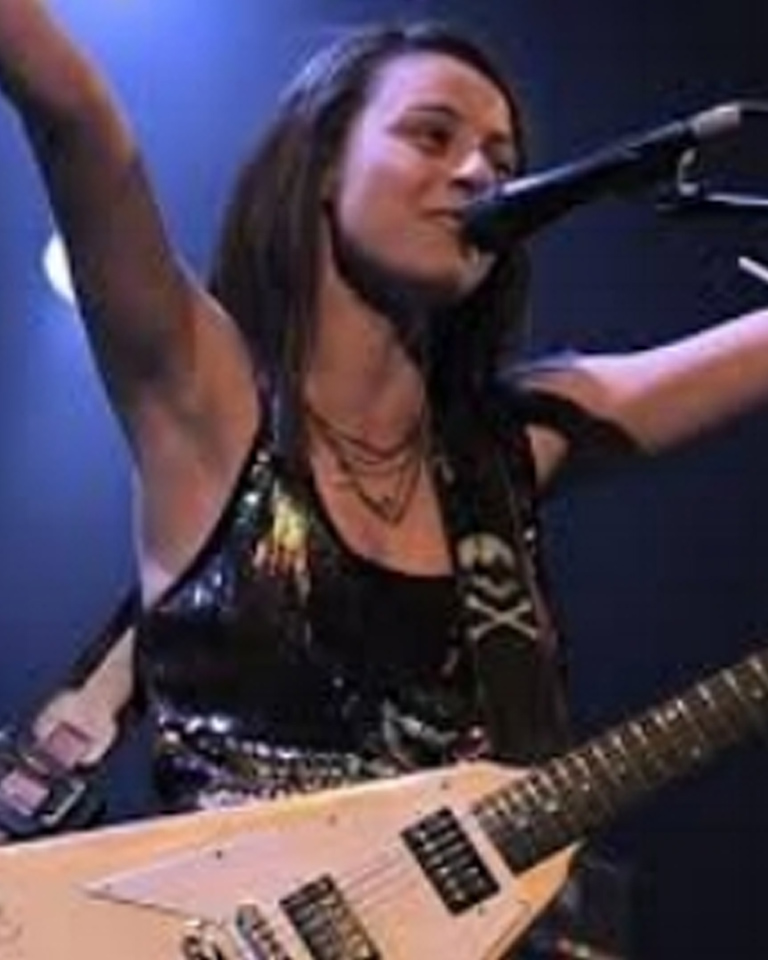 "Born: Simleul Silvanie, Romania 26 November 1989 Now: Woodstock, New York Kristen gravitated guitar driven music. She has shared the stage with Lady Antebellum, Gavin DeGraw, Bret Michaels, Wyclef Jean, Kenny Greenberg, Michael Schenker Group, Les Paul, James Burton and Al DiMeola. Kristen's Vocal Coach; Don Lawrence whose resume includes such talent as Mick Jagger, Bono, Christina Aguilera, Lady Gaga and Tony Bennett .Kristen endorsements include"" Gibson Guitars, Epiphone Guitars, PRS Guitars, D'Addario Strings, Eminence Speakers and Wampler."