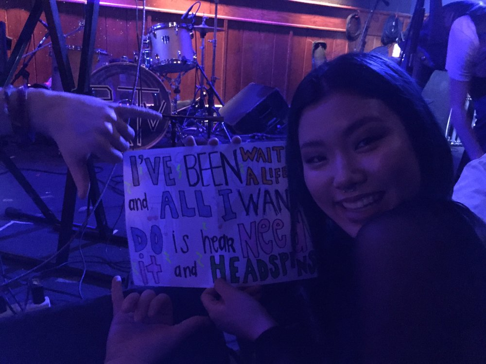 Annie Ruzga with her sign made from Splashh song titles