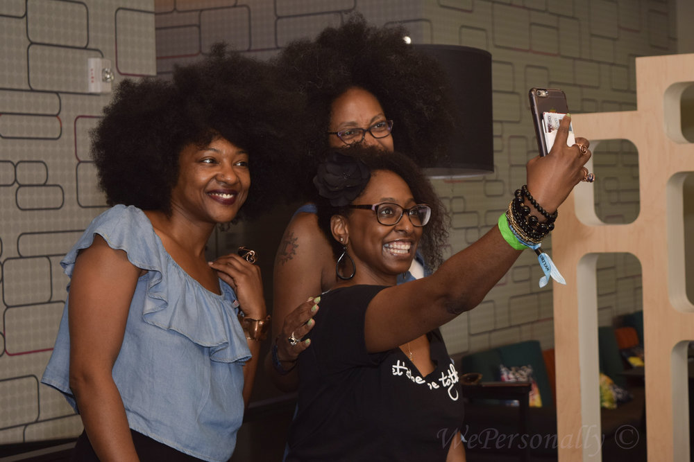 "(Left) Founder of ""Let's Be Dope Together"" Angel Dozier poses for a quick selfie with friends!"