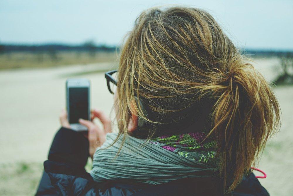 woman mobile phone digital detox.jpg