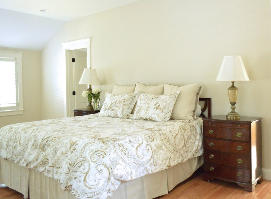 Serene master bedroom painted in Benjamin Moore's White Sand.jpg