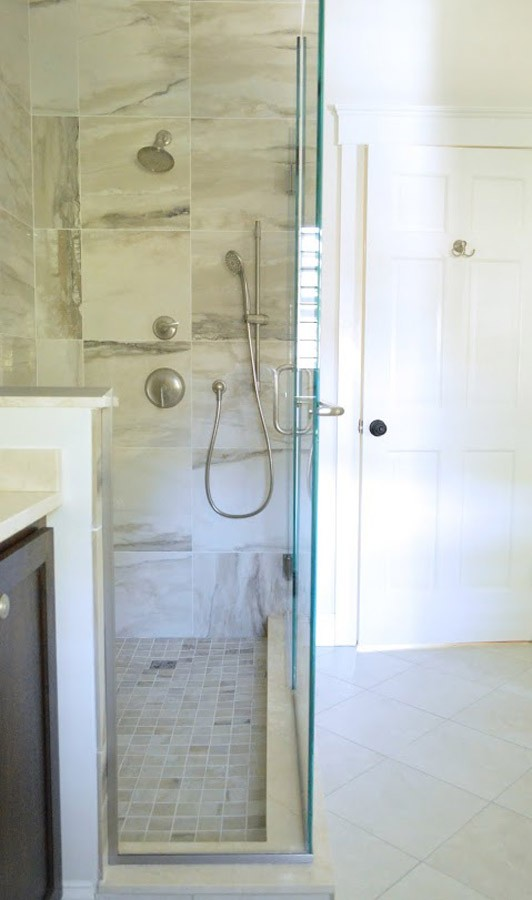 Floor to ceiling tile creates for an impressive walk-in shower.jpg